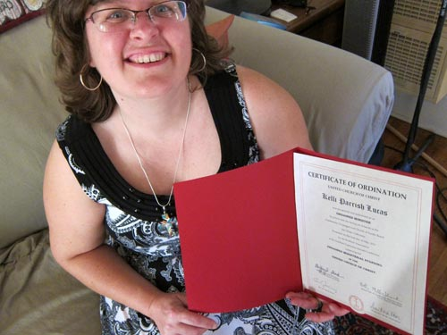 Kelli beaming with ordination certificate finally in hand.